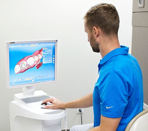 Dentist looking at intraoral images on computer screen